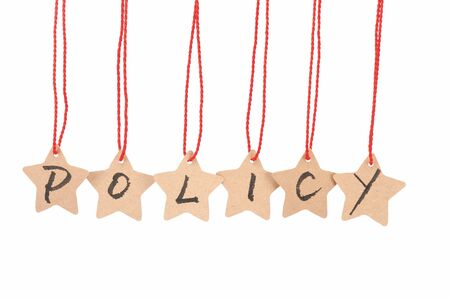 programm: Policy word spelled with paper stars  are hung by ropes, isolated against white background