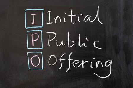 public offering: IPO - Initial public offering words written on the chalkboard