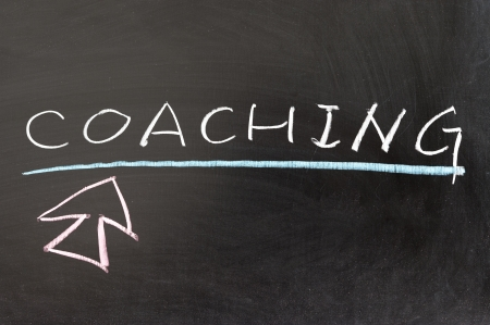 work experience: Coaching word and mouse pointer drawn on chalkboard