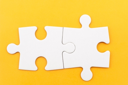 two pieces: Group of white paper jigsaw puzzles