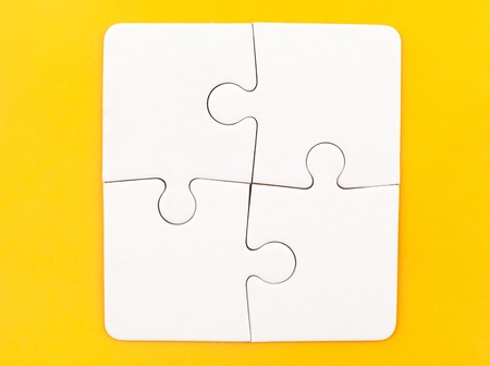 four objects: Group of white paper jigsaw puzzles