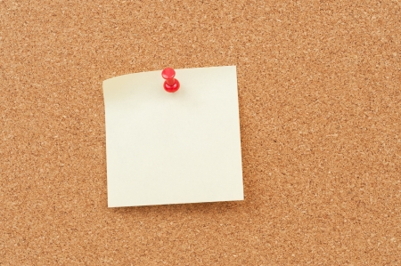 close up view of thumbtack and note on corkboard Stock Photo - 18656787