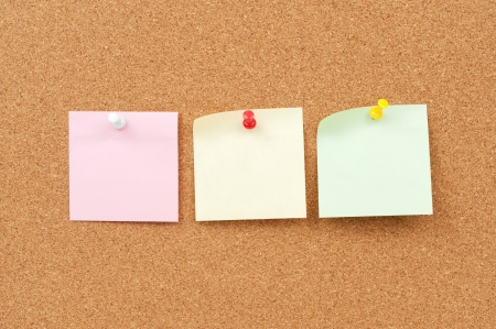 close up view of thumbtack and note paper group on corkboard Stock Photo - 18656791