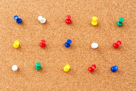 Group of thumbtacks pinned on corkboard Stock Photo - 18656884