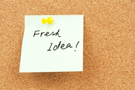 Fresh idea words written on paper and pinned on corkboard Stock Photo - 18656755