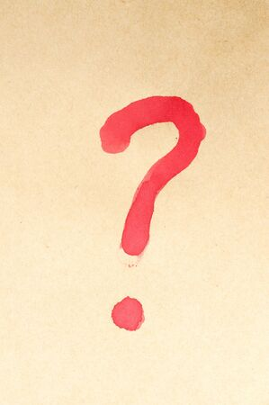 Question mark symbol written on brown paper photo