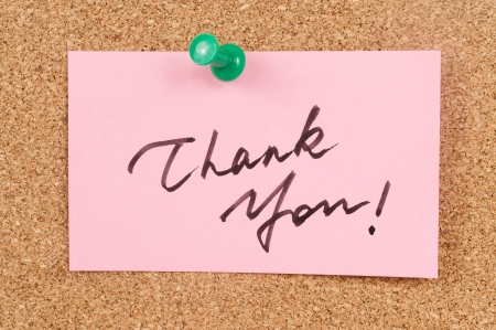 tack board: Thank you words written on paper and pinned on corkboard