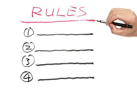 Liste Regeln auf weißem Papier geschrieben Standard-Bild - 19486414
