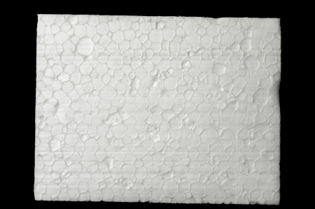 styrene: A piece of polystyrene foam isolated on black background