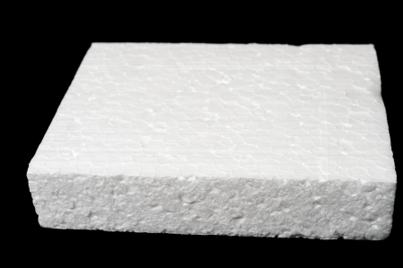 A piece of polystyrene foam isolated on black background