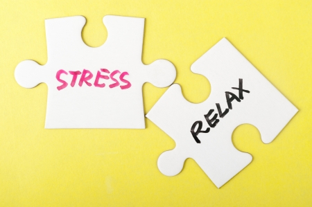 destress: Stress and relax words written on two pieces of jigsaw puzzle Stock Photo