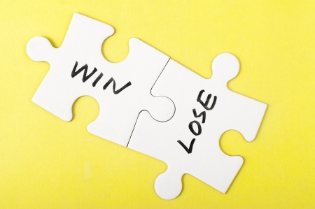 word game: Win and lose words written on two pieces of jigsaw puzzle Stock Photo