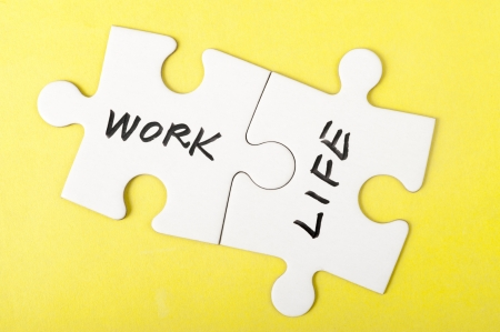 life metaphor: Work and life words written on two pieces of jigsaw puzzle Stock Photo