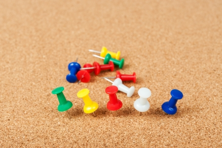 tack: Group of thumbtacks pinned on cork board Stock Photo