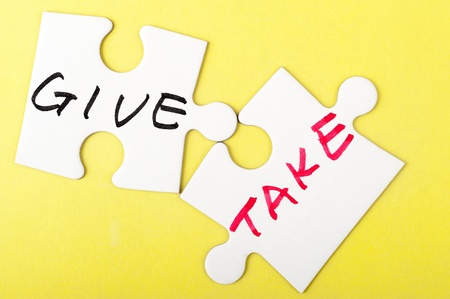 contribute: Give and take words written on two pieces of puzzle