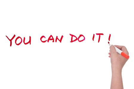 ��You can do it!�� words written on white board photo