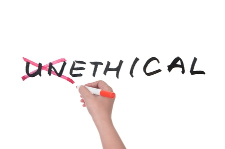 unethical: Unethical to ethical concept,hand writing on white board Stock Photo