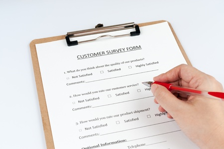 FIlling customer survey form using a red pen photo