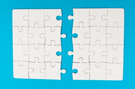 detach: Group of white paper jigsaw puzzles