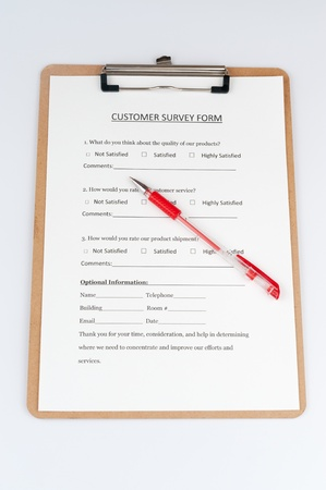 Customer survey form with a red pen on it photo