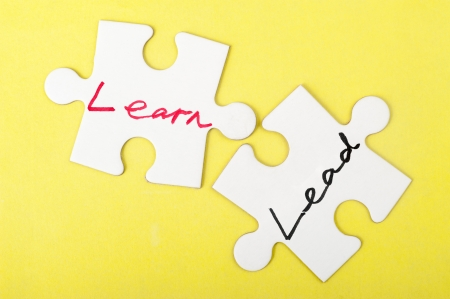 Lead and learn words written on two pieces of jigsaw puzzle photo