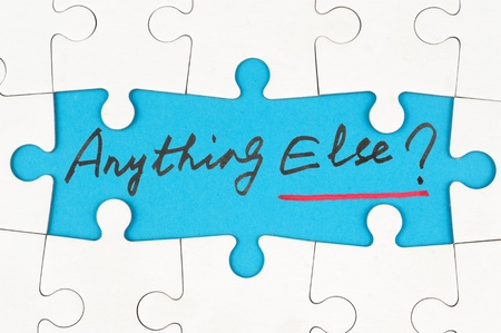 else: Anything else? words written on paper inside group of jigsaw puzzles