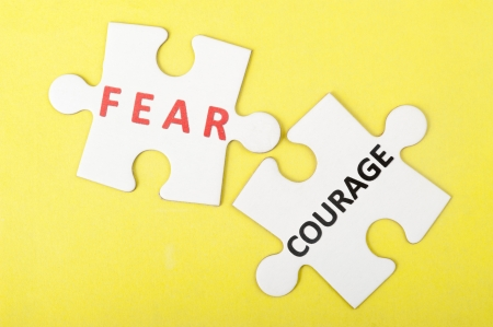 unafraid: Fear versus courage concept with two pieces of jigsaw puzzle