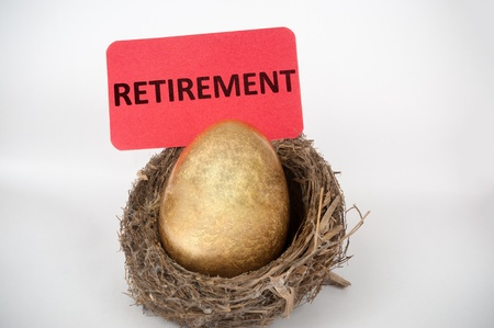 Retirement concept with golden egg in the bird nest photo