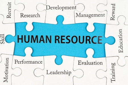 Human resource concept words on group of jigsaw puzzle pieces photo
