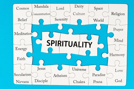 chakra symbol: Spirituality concept words on group of jigsaw puzzle pieces