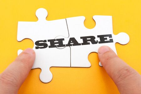 contribute: Share concept word on two pieces of jigsaw puzzle Stock Photo