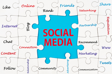 tweets: Social media concept words on group of jigsaw puzzle pieces Stock Photo