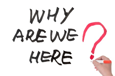 we: Why are we here words written on white board