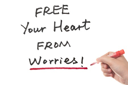 Free your heart from worries words written on white board photo