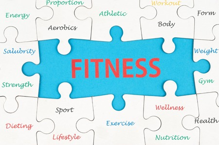 Fitness concept wordcloud on group of jigsaw puzzle pieces