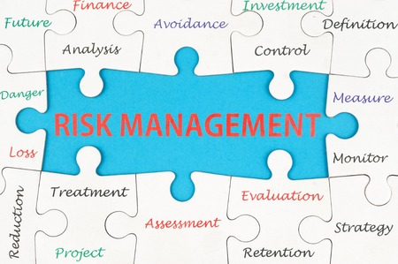 reduce risk: Risk management concept words on group of jigsaw puzzle pieces