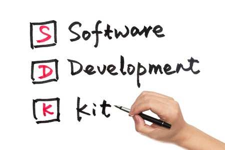 compiler: SDK - software development kit words written on white paper