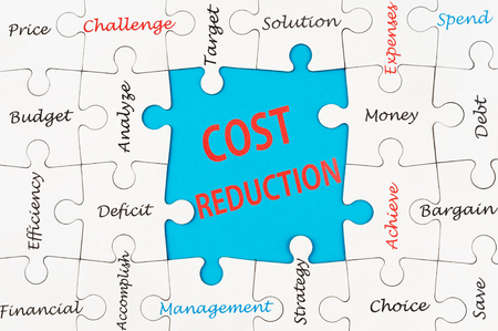 cost reduction: Cost reduction concept word cloud on group of jigsaw puzzle