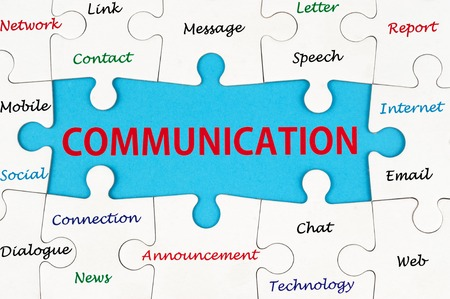 communication metaphor: Communication concept words on group of jigsaw puzzle Stock Photo