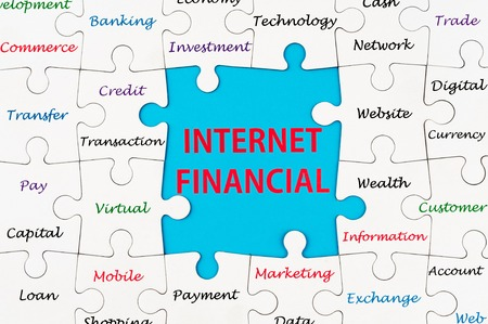 Internet Financial concept words on group of jigsaw puzzle pieces photo