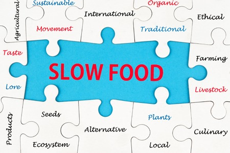 Slow food concept word cloud on group of jigsaw puzzle pieces