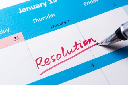 new years resolution: Resolution word written on the calendar with a pen