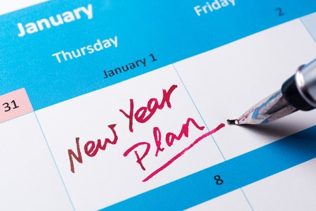 new years day: New year plan words written on calendar