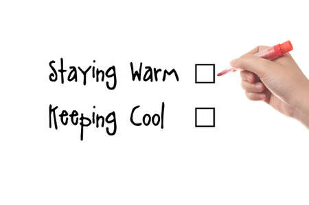 staying: Staying warm and keeping cool words written on whiteboard Stock Photo