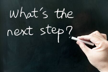 move ahead: Whats the next step words written on the blackboard using chalk
