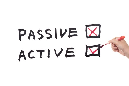passive: Passive or Active words written on white paper