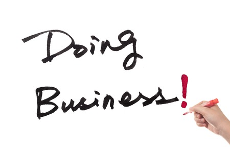 doing business: Doing business words written on white paper Stock Photo