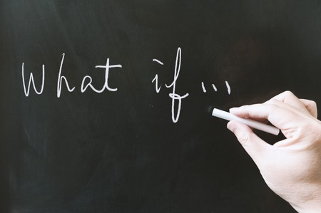 possibility: What if words written on blackboard using chalk Stock Photo