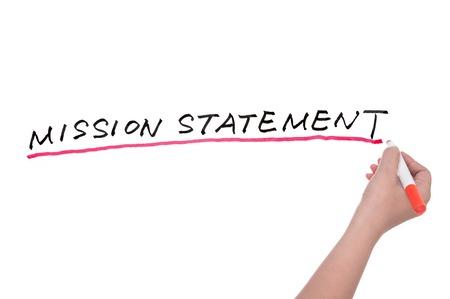 ホワイト ボードに書かれたミッション ステートメントの言葉
