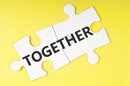 two piece: Together  word on two pieces of jigsaw puzzle Stock Photo